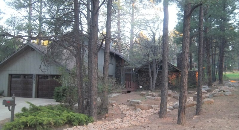 Private Home on a large wooded lot backing to the golf course in a quiet neighborhood.