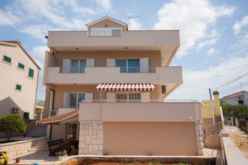 Our apartment are very suitable for 8 persons. It has big yard and grill.