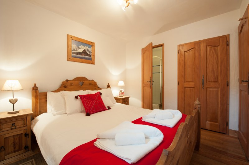 The master double bedroom is well-lit and has an ensuite shower room for extra comfort