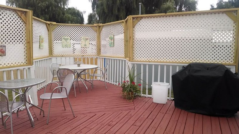 Party deck with privacy and a BBQ too.