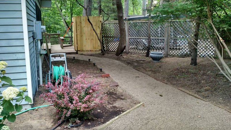 Side yard showing outdoor shower and back yard