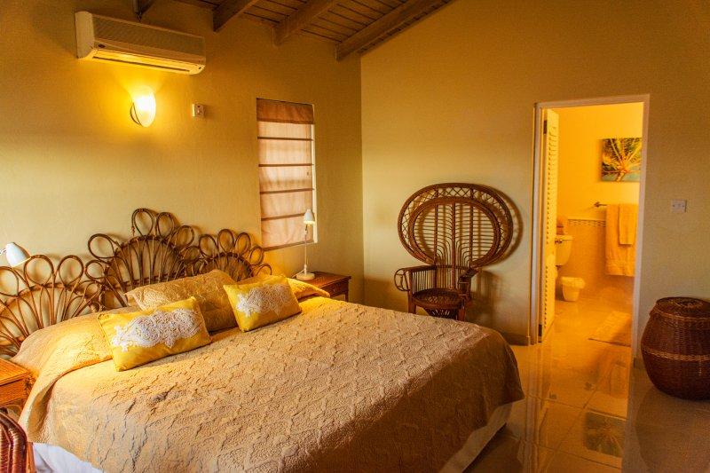 Master en suite Bedroom with ocean and garden views