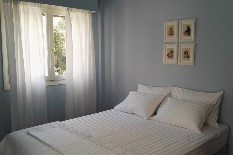Comfortable sunny double bed room with luxury linen and mattress