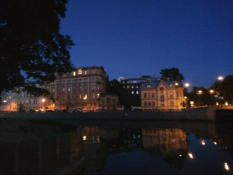 White nights, charming Moika embankment at the corner of New Holland island.