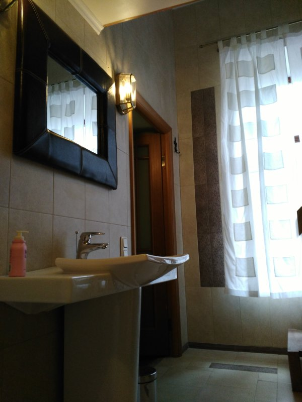 Bathroom with the window and heated floor