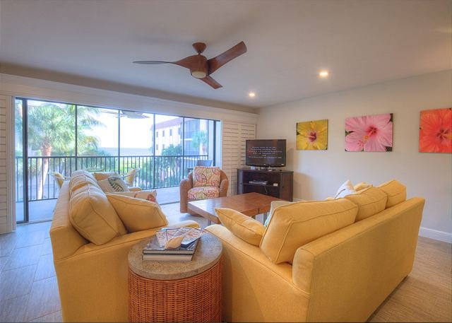 Spacious living room and screened lanai with Gulf of Mexico view