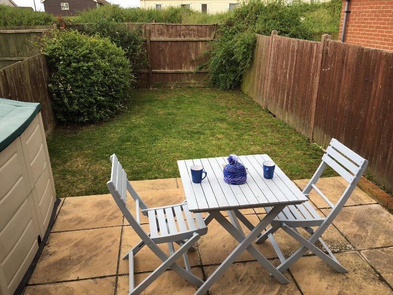 Secure rear garden with patio