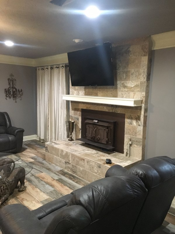 Gathering room with comfy sofa, and chairs, fireplace, large screen TV