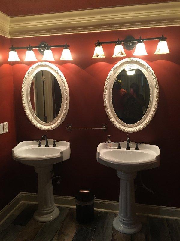 Double vanities with pedestal sinks in Master Suite