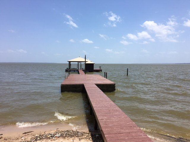 Our long pier with boathouse. It's great for fishing and swimming! Sandy beach at the shoreline!