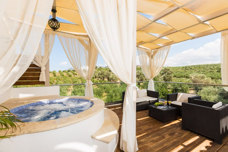 The large balcony is equipped with an outdoor whirlpool and wooden deck!