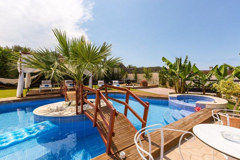 Great pool design with wooden bridge!