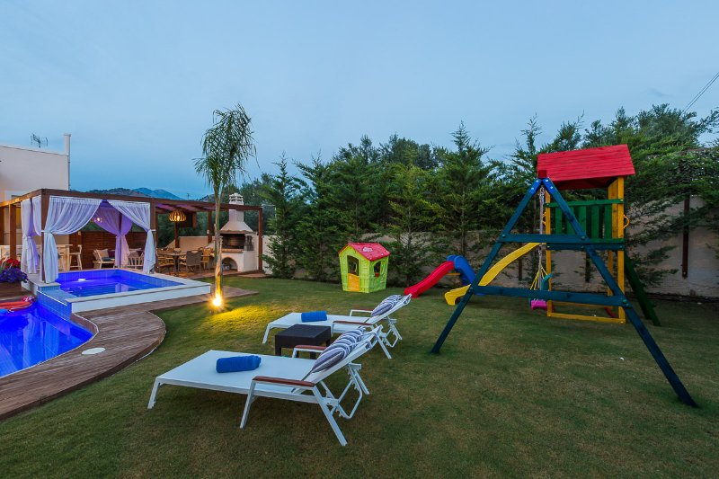 Lay by the pool and relax while your children are at the playground!