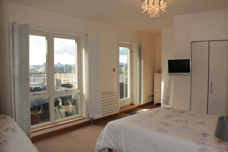 Large family bedroom: double & single bed, dressing area, en-suite bathroom & balcony with hot tub.