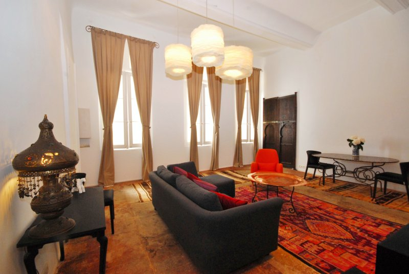 Fantastic living room with 15 foot ceilings and gorgeous furniture and fittings. A dream apt.