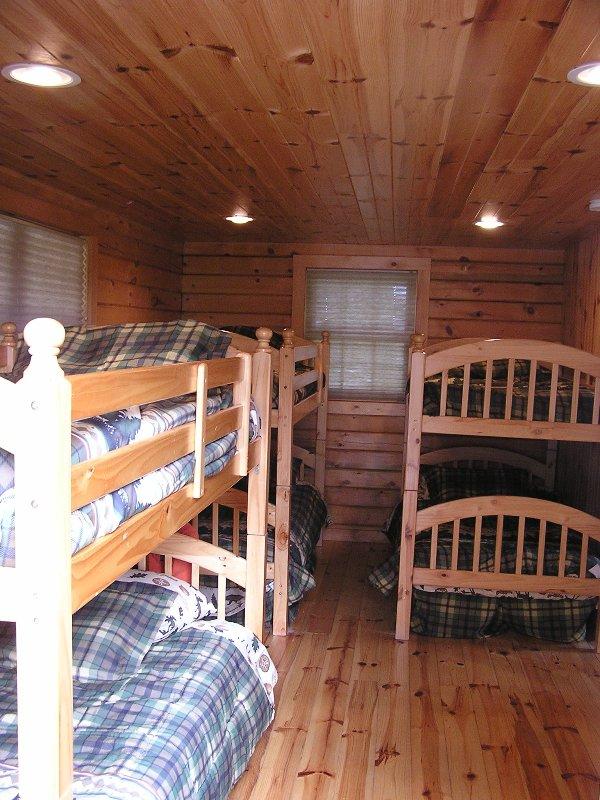 Bedroom has three bunk beds