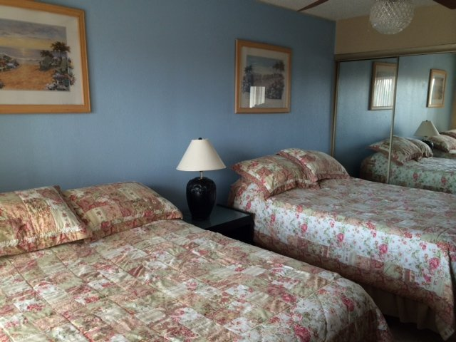 Two full-size beds in the bedroom.