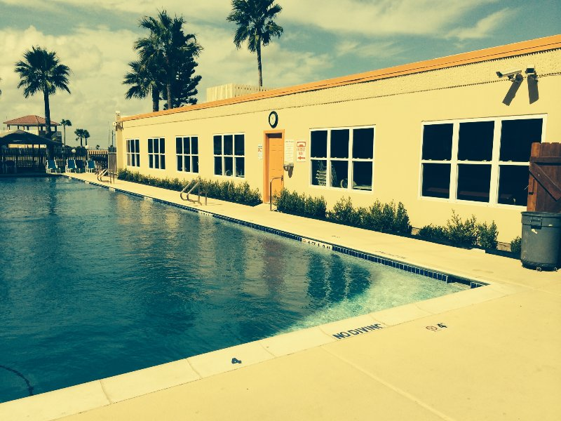 Our clubhouse with a terrific pool, hot tub, kiddie pool, and bar-b-cue grills.