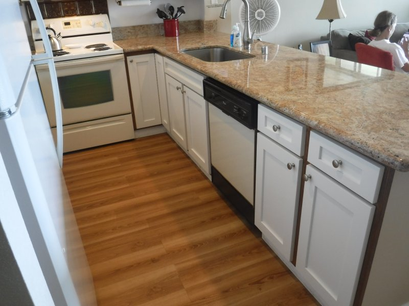 A newly remodeled kitchen with granite counter tops and new cabinets