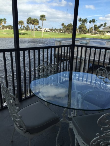 Patio for eating outside to enjoy the wide water and golf course view.  Watch  roseate spoonvbills