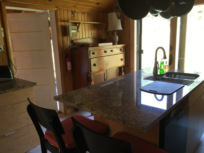 New kitchen with granite island and maple cabinets