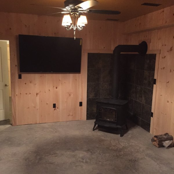gameroom with bigscreen and stove