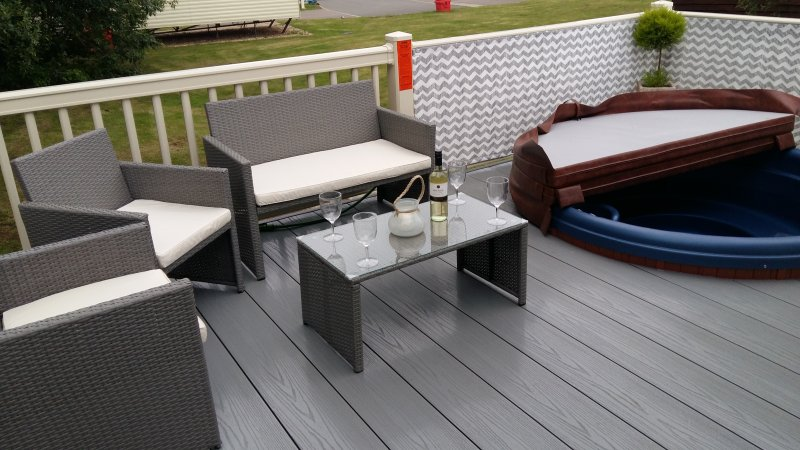 Enjoy a glass of vino on the decking with the comfy seating area