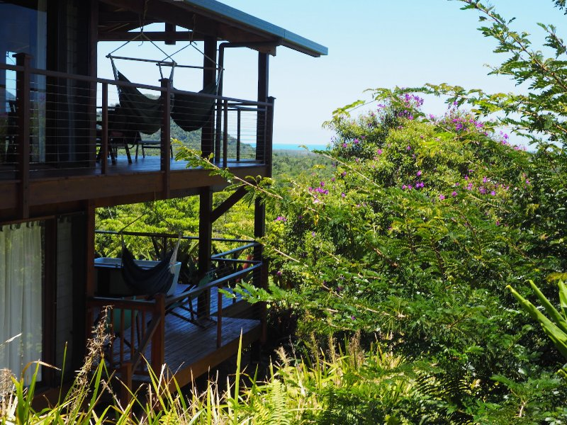 view of house and garden with coral sea