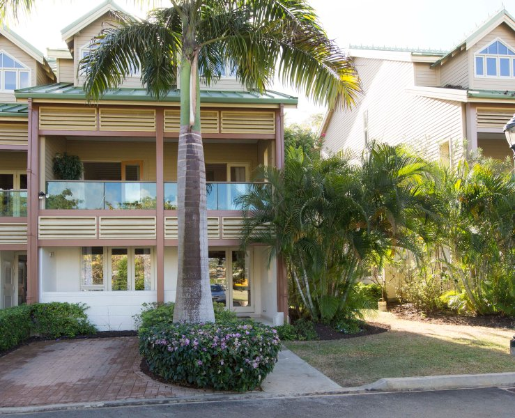 Facade - manicured gardens; palm and bay trees