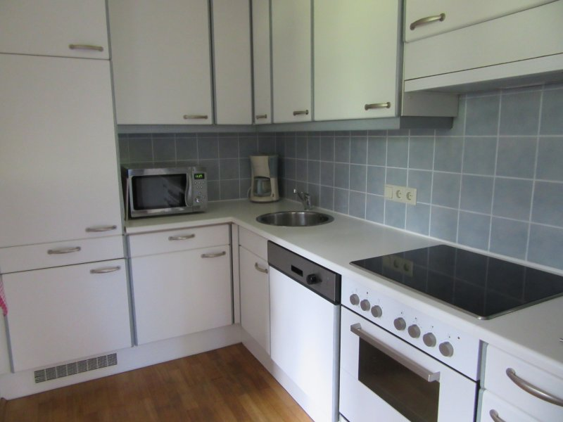 Kitchen, equipped with full size oven and hob, microwave, dishwasher and washing machine/dryer.