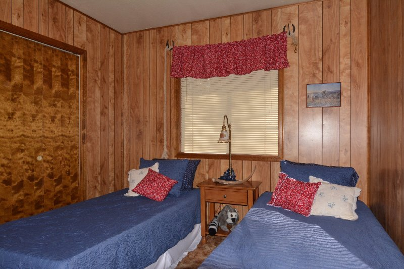 Cow boy room with 2 extra long twin beds
