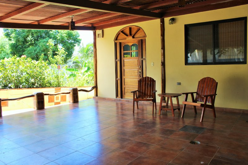 Spacious front porch at entryway of home.  Sit outside and watch the birds while drinking your coffe
