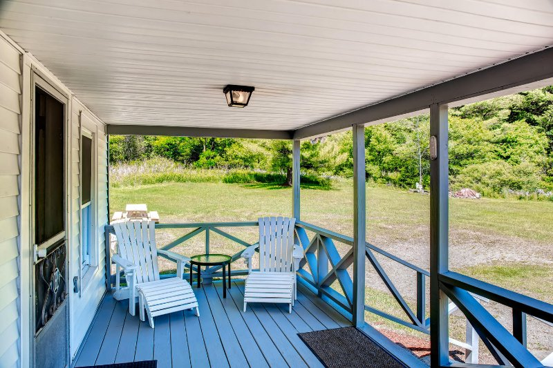 Enjoy your morning cup of coffee on this spacious porch.