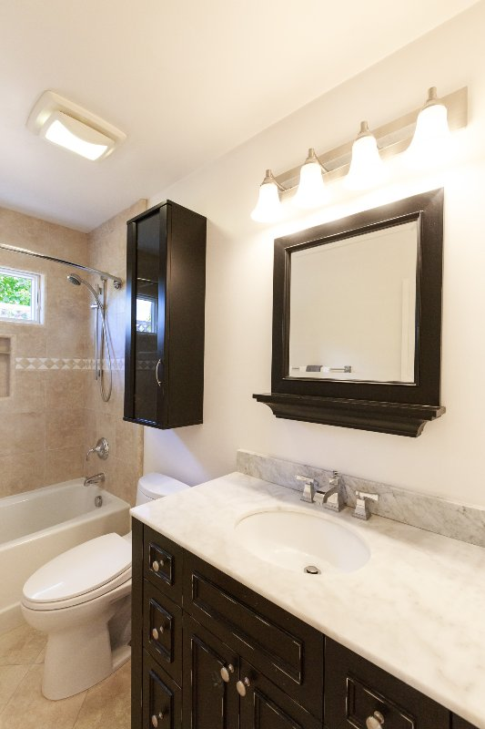 Full Bathroom with Marble Counter