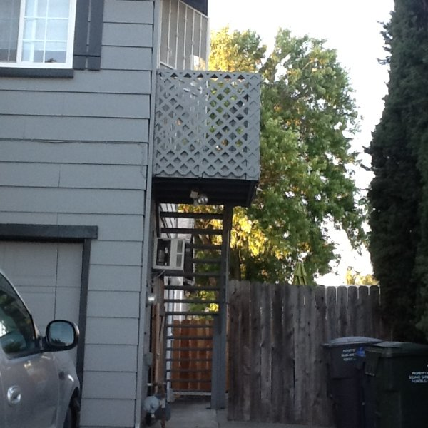 Outside staircase behind gated entryway. Upstairs and downstairs entries have security screen doors.