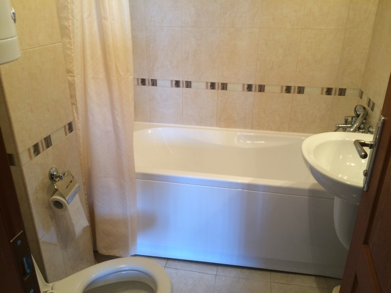 Family bathroom with bath and shower.