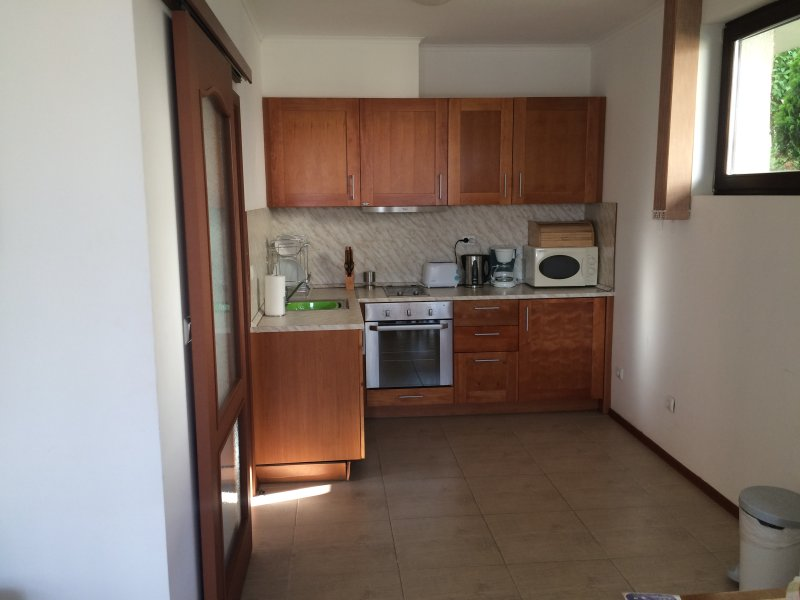 Kitchen with fridge, oven, hob and extractor, microwave, toaster, coffee maker.  Fully equipped.