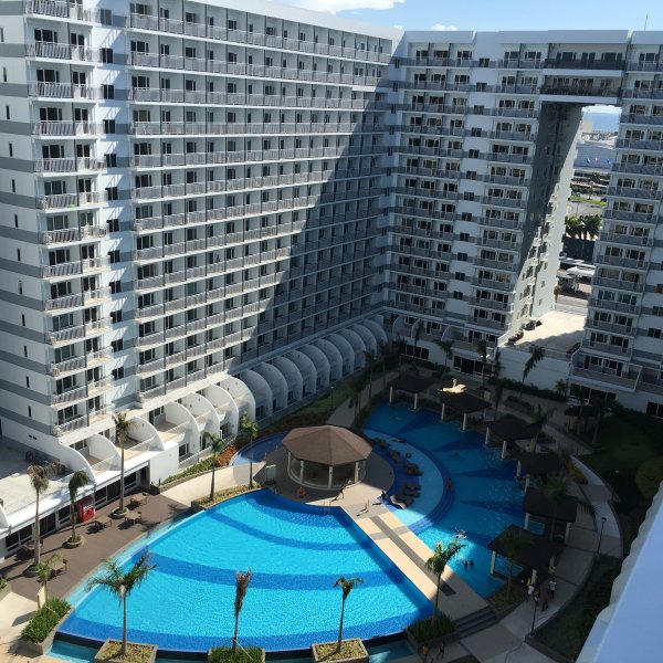 The breathtaking view of the swimming pool from the apartment balcony.
