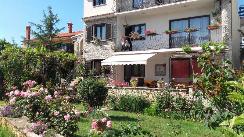 Haus Goga Pomer Orange apartment, location de vacances à Pomer