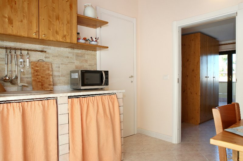 apartment with furnished kitchen , bedroom, private bathroom