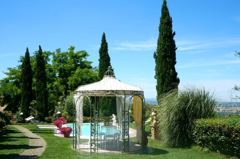The private pool situated on the lawned terrace with romantic gazebo and views