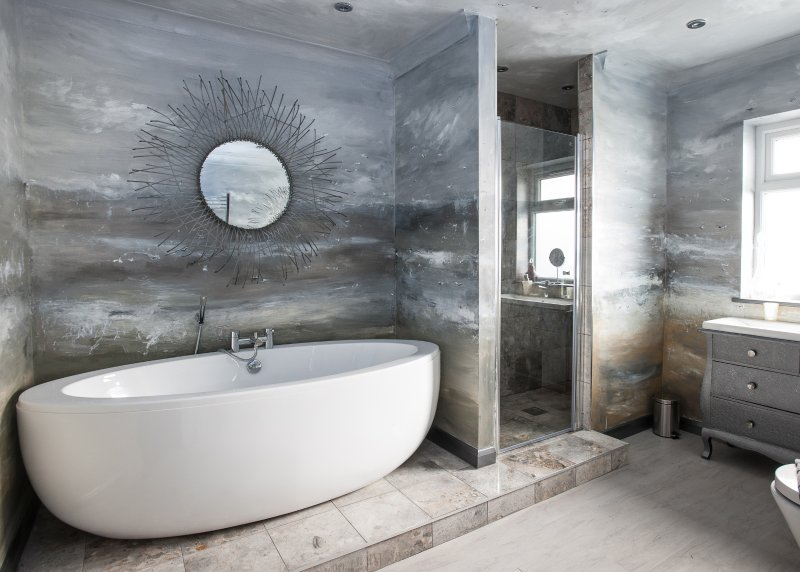 Bathroom with unique seascape mural