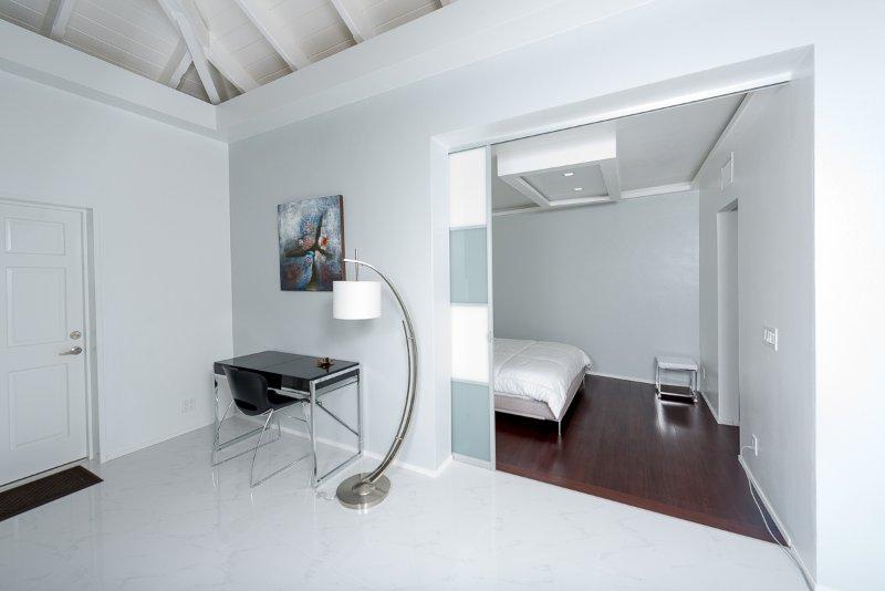 computer desk and bedroom entrance