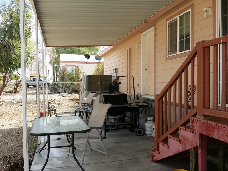 Back patio with gas BBQ and large fenced in yard.  Pets welcome.