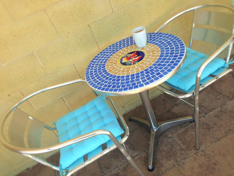 On front patio - relax, enjoy your morning coffee and paper or later a nice coldie and glass of red!