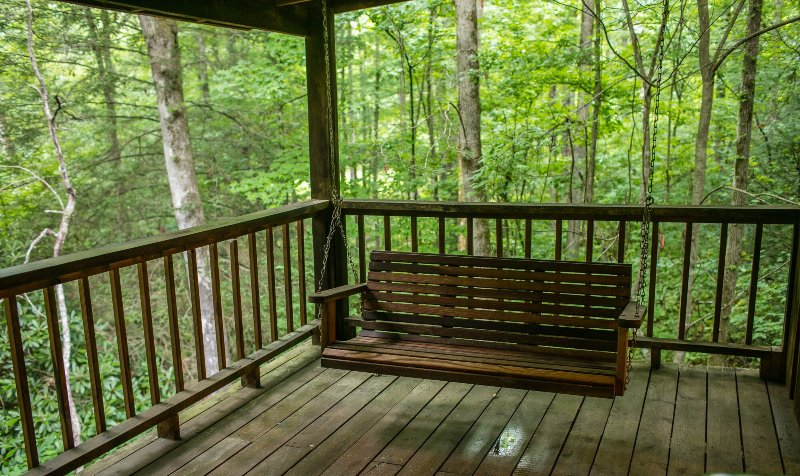Relax in the porch swing and listen to the water run over the rocks in the creek.