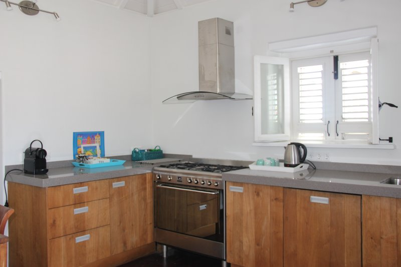 Spacious kitchen with Nespresso coffee maker, water kettle, gas cook top and oven.
