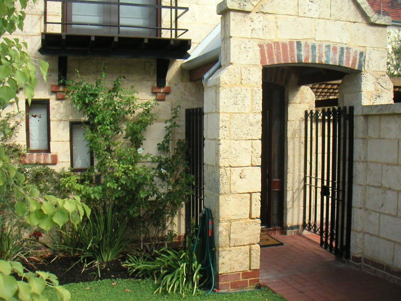 Entry from quiet off-street access. Pretty Juliet balcony shown opens off main bedroom.