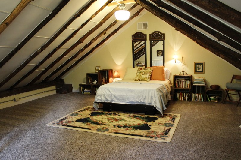 Private lofT bedroom above kitchen- access from main level bathroom- Overlooks Pond