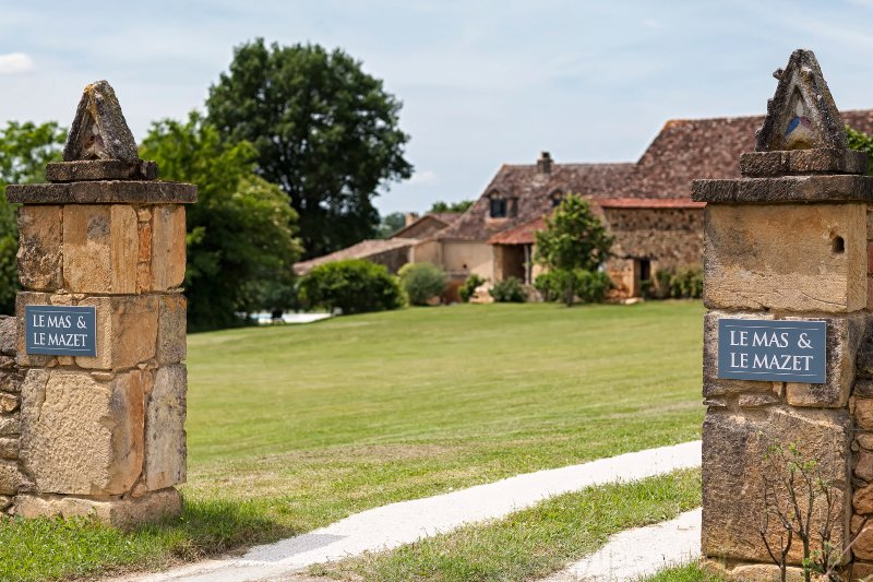 The stone gates welcoming you to Le Mas & Le Mazet